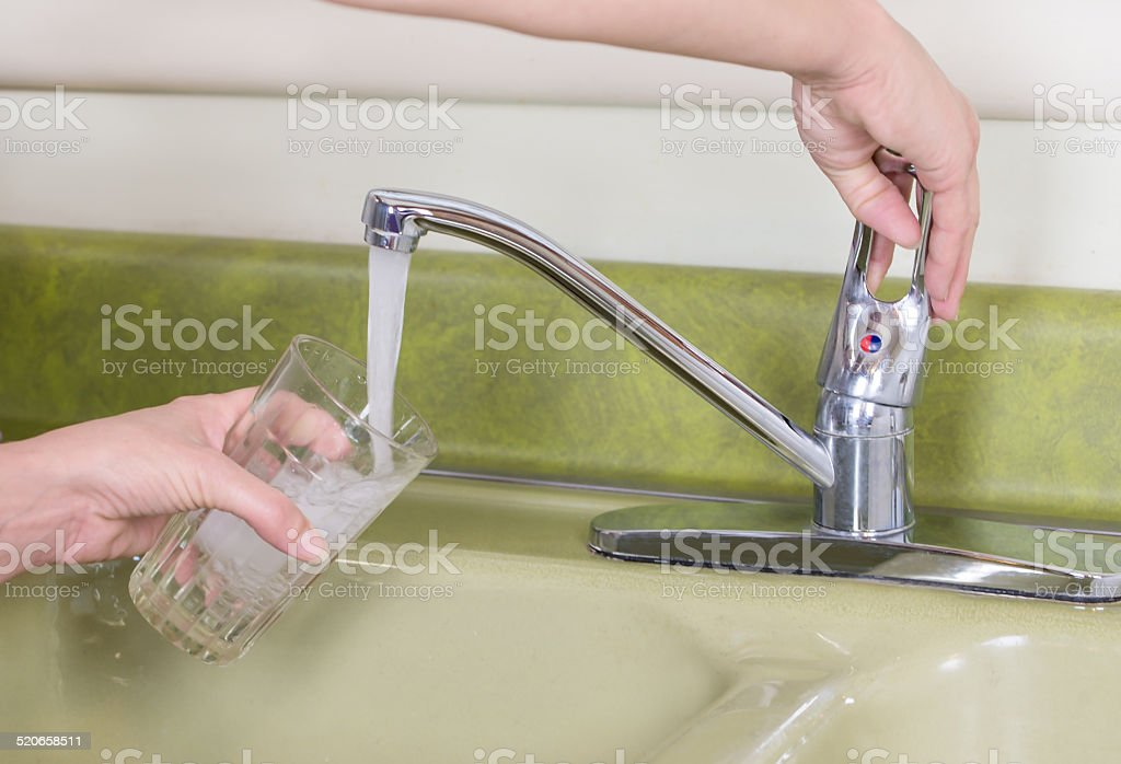 Tap Water from Sink stock photo