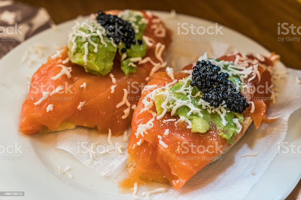 Tapa of smoked trout and caviar stock photo
