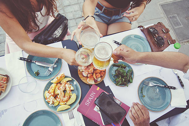 tapas and beer toast - spanish food stock photos and pictures