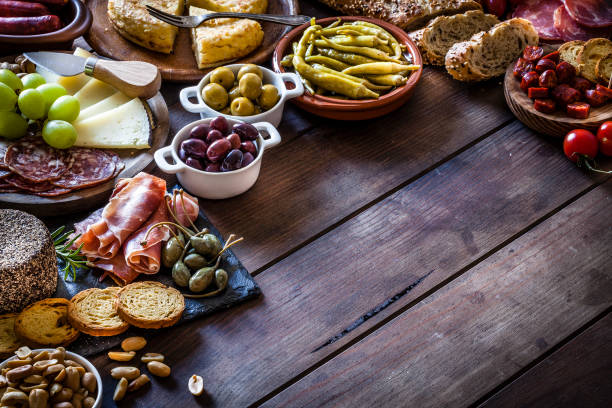 Tapas frame on rustic wooden table stock photo