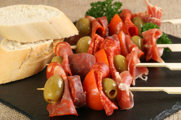 tapas meat olive and tomato stock photo