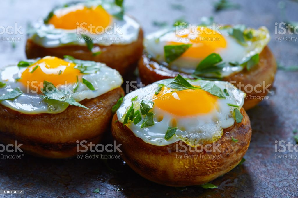 Tapas mushrooms with quail eggs from Spain stock photo