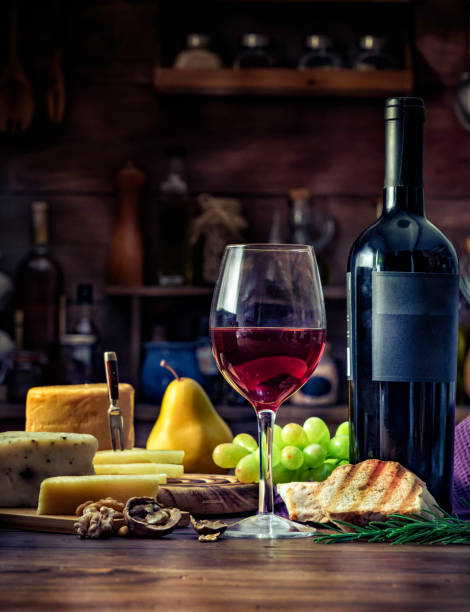 Tapas of cheese, cured ham, salami wine and chorizo on a rustic wooden table stock photo