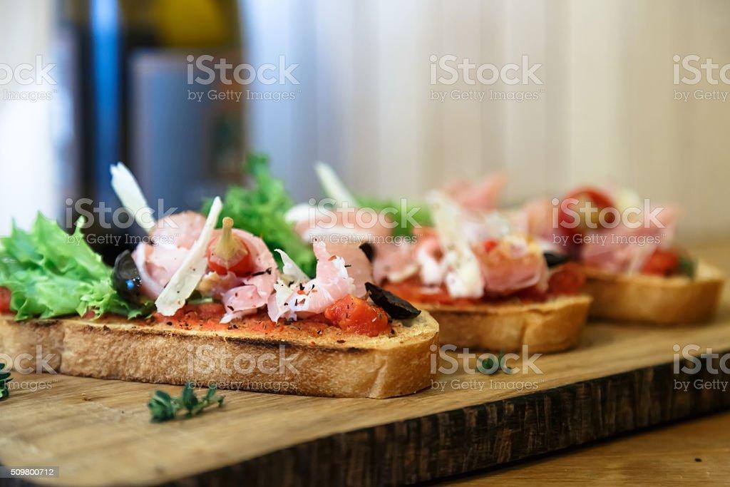 Tapas on Crusty Bread - Selection of Spanish tapas. stock photo