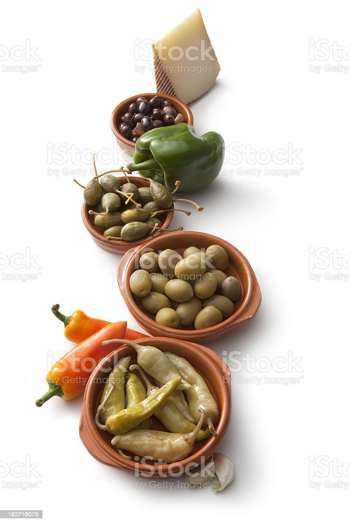 Tapas: Peppers, Olives, Capers and Manchego royalty-free stock photo