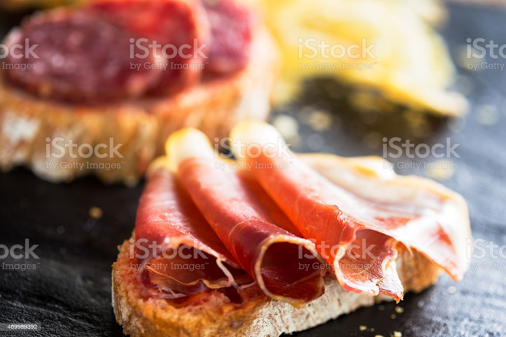 "Tapas Typical spanish appetizer called ""pinchos"" with spanish ham and slice of bread. 2015 Stock Photo"