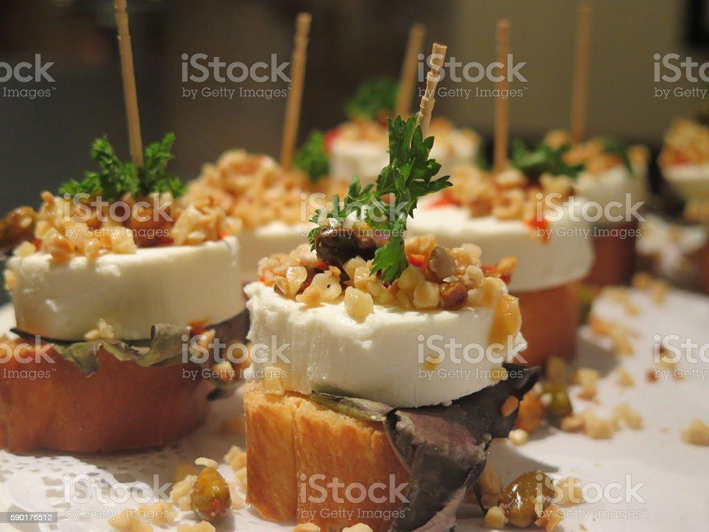 Tapas Pintxo goatcheese parsley pistacio crusty bread stock photo