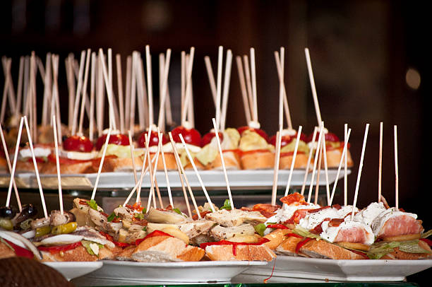 tapas platters of fresh bread with toppings - spanish food stock photos and pictures