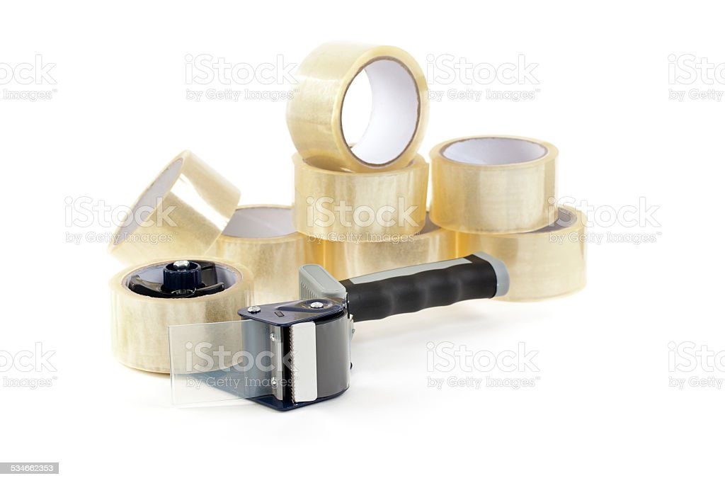 Tape Gun and Several Rolls of Tape stock photo