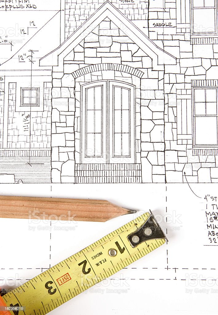Tape Measure and Carpenter's Pencil on Home Plans (Front Entry) royalty-free stock photo