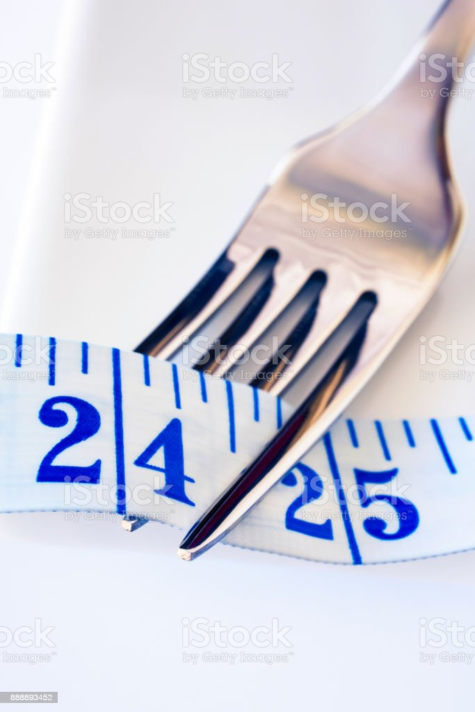 Tape Measure and Fork Slimness and Diet Concept stock photo