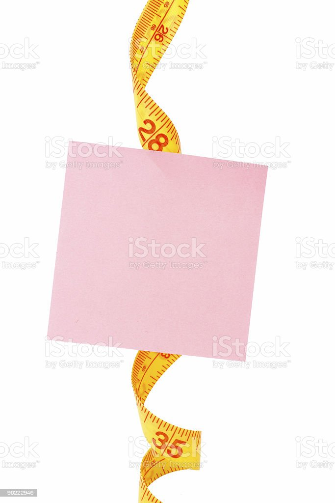 Tape Measure and notepaper royalty-free stock photo