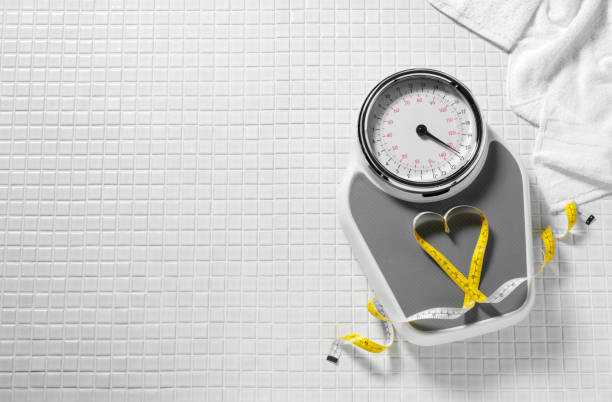 Tape Measure and Weighing Scales stock photo