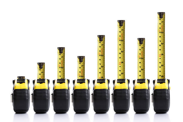 Tape measure bar chart Tape measure bar graph concept with positive trend tape measure stock pictures, royalty-free photos & images