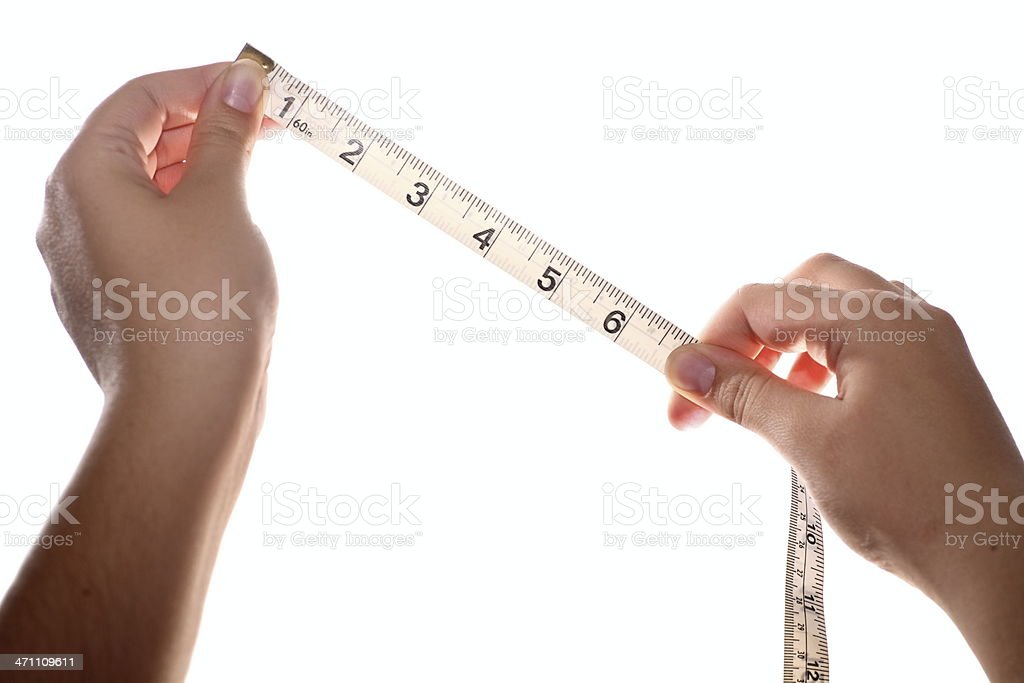 Tape measure in hands royalty-free stock photo