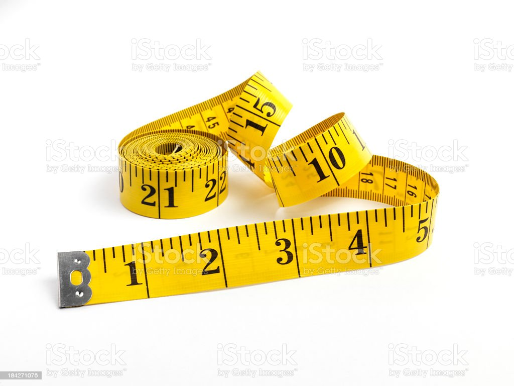 Tape measure in yellow measuring in inches stock photo