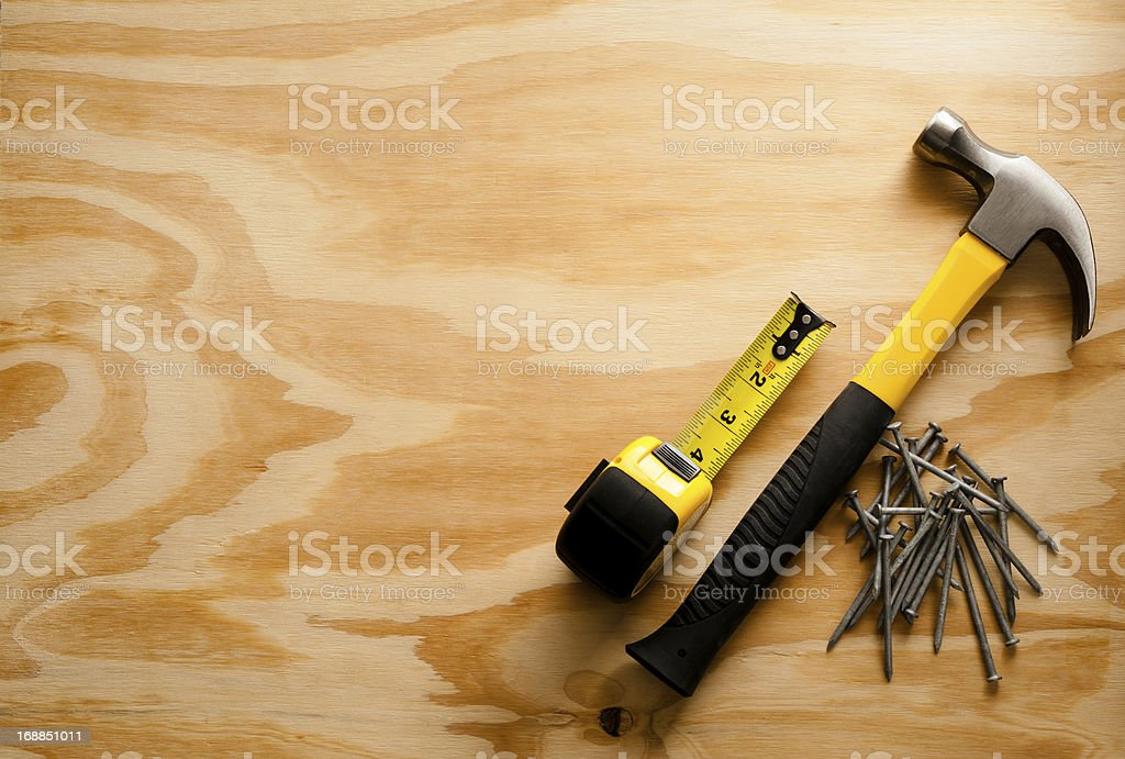 Tape Measure Nails and Hammer on Wood royalty-free stock photo