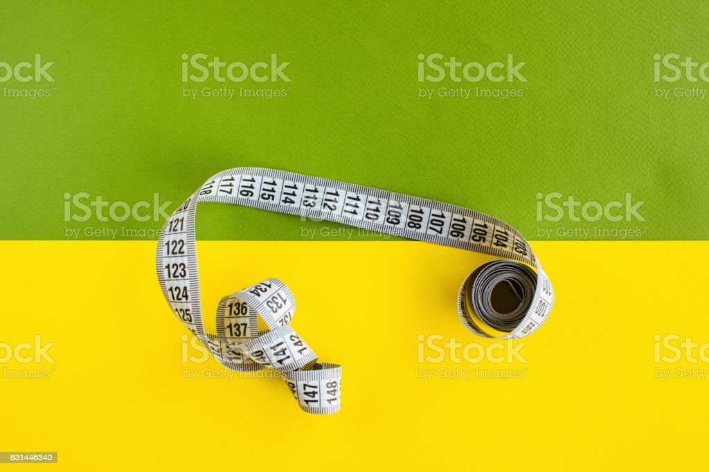 Tape measure on colorful background stock photo