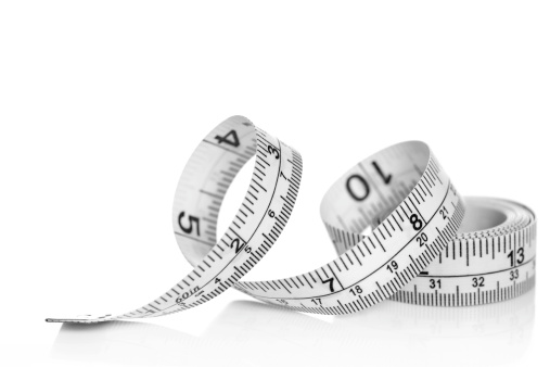 White tape measure on white background with reflection