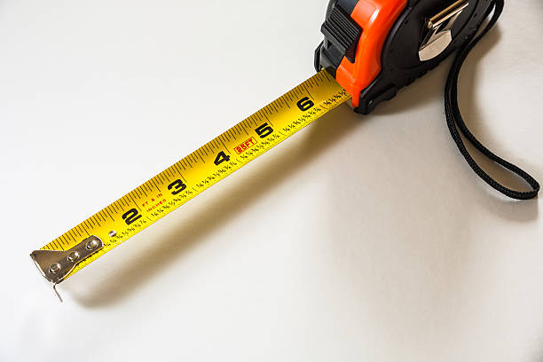 Tape measure on white stock photo