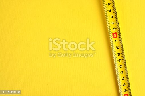 Tape measure scale on a yellow background. Copy space.