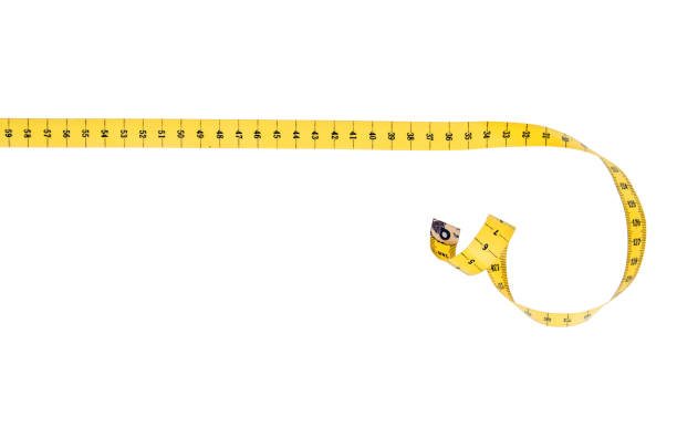 Tape measure with curl, isolated on white. Straight line fabric tape measure with curl. tape measure stock pictures, royalty-free photos & images