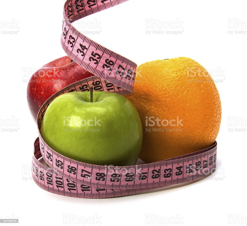 tape measure wrapped around fruits royalty-free stock photo