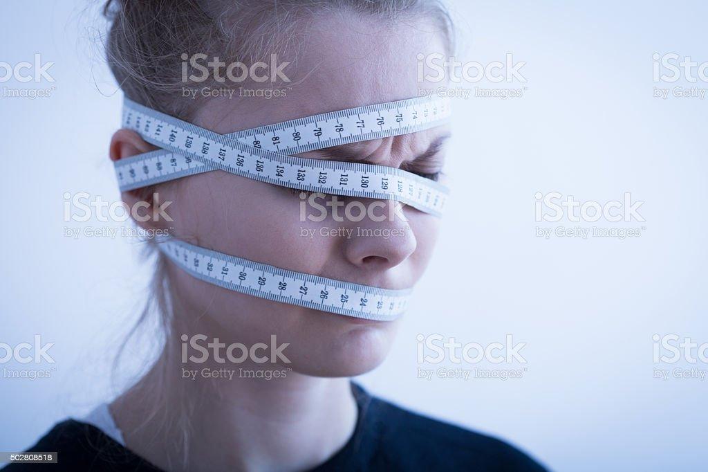 Tape measure wrapped around head stock photo