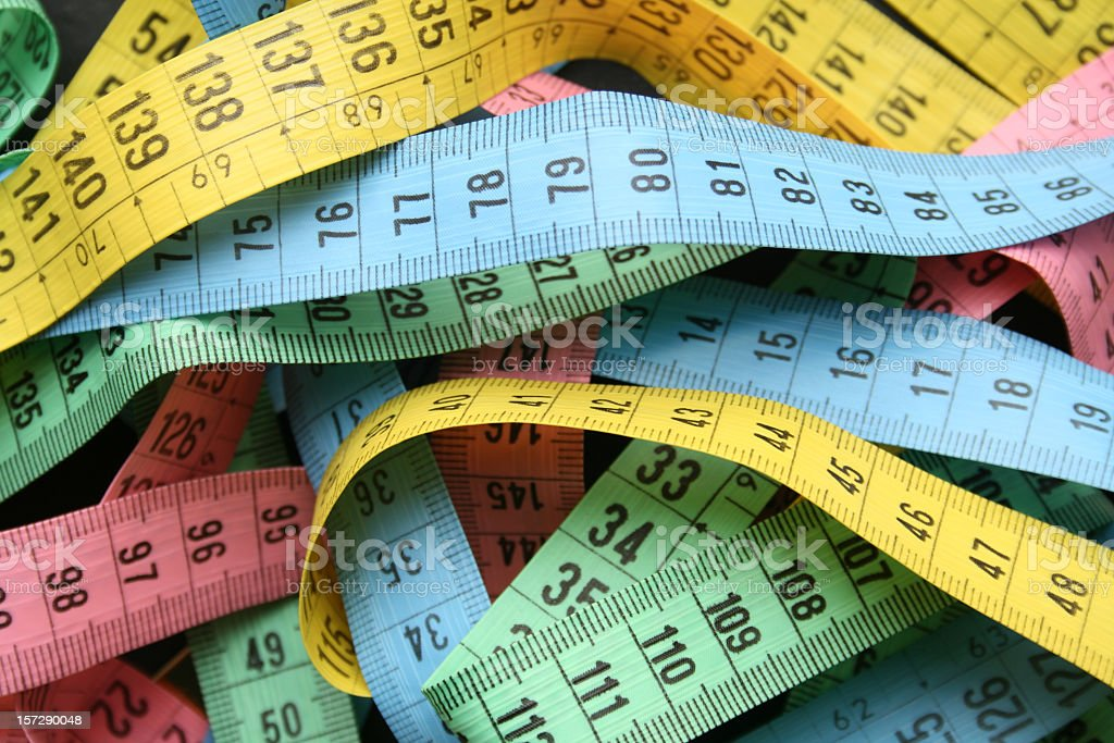 Tape measures background royalty-free stock photo