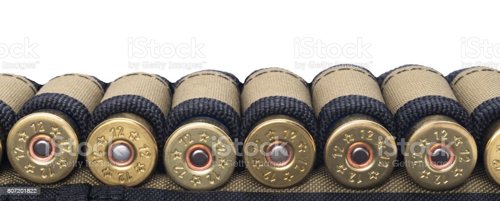 Tape with cartridges for hunting rifle, concept on white background stock photo
