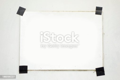 istock Taped blanc white a4 paper on the wall 186595201