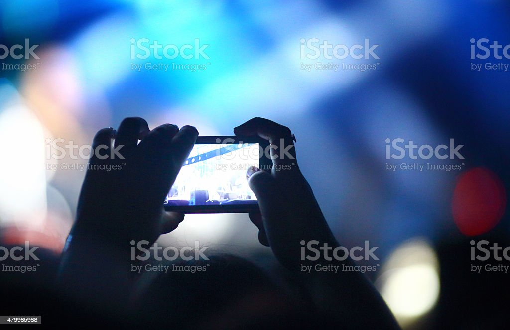 Taping a concert with smartphone. stock photo