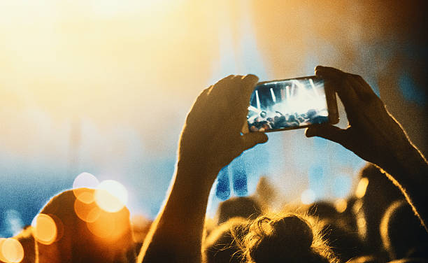 taping a concert with smartphone. - concert selfie stock photos and pictures