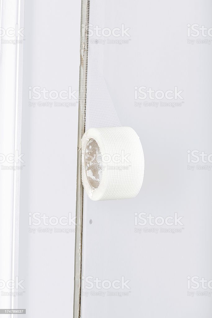 Taping a Plasterboard seam stock photo