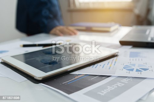 858031152istockphoto Taplad with business graphs and charts report , calculator on desk of financial planing. Financial abstract concepts. 871801698