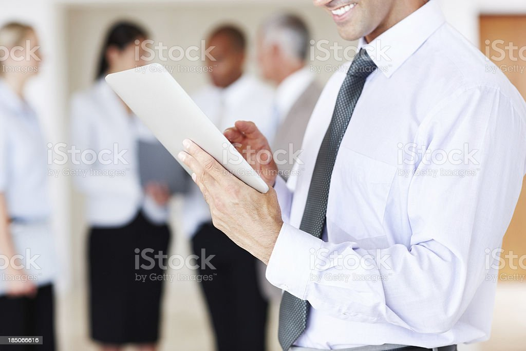 Tapping into the corporate world with a touchscreen royalty-free stock photo