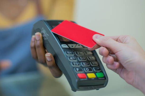 tapping to pay - paying with card contactless imagens e fotografias de stock