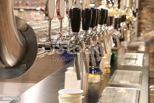 istock taps of the brewery to spice fresh beer to quench the customers 886557422