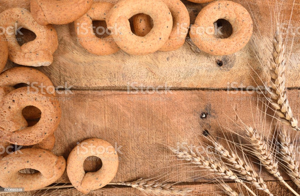 Taralli on the wood table,Traditional Italian snack from Puglia. stock photo