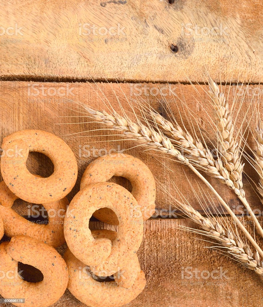 Taralli on the wood table,Traditional Italian snack from Puglia stock photo