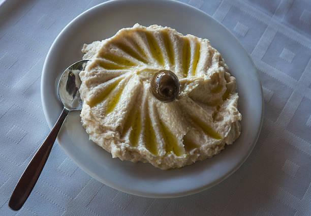 taramasalata in white platter with olives - taramosalata stock-fotos und bilder