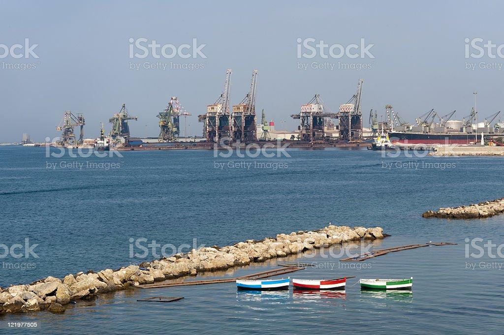 Taranto (Puglia, Italy) - Harbor and three boats stock photo