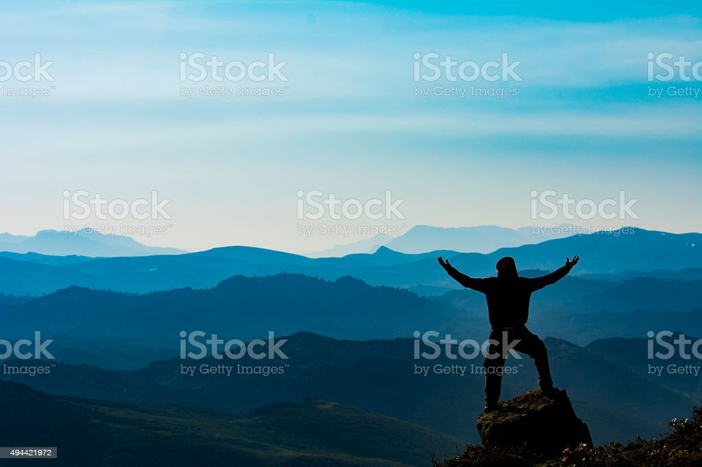target achievement at the summit of the mountain stock photo