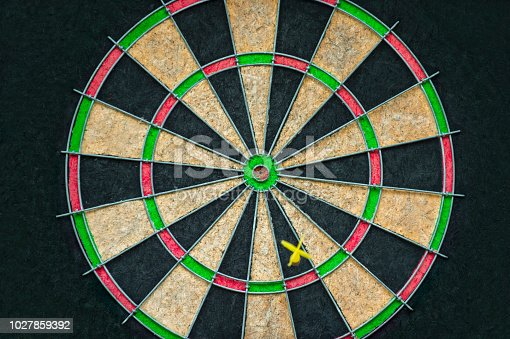 istock Target dart board on the black background, center point, head to target marketing and business concept 1027859392