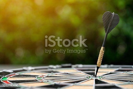 istock Target dart board on the table, center point, head to target marketing and business success concept 1033160590