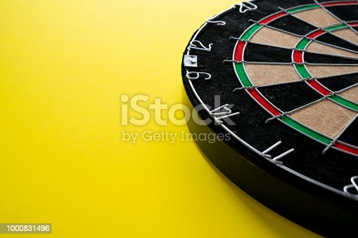 istock Target dart board on the yellow background, center point, head to target marketing and business concept 1000831496