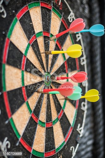 istock Target dart game with one win arrow hit on middle point spot and many missing for competitive business marketing concept 1160705669
