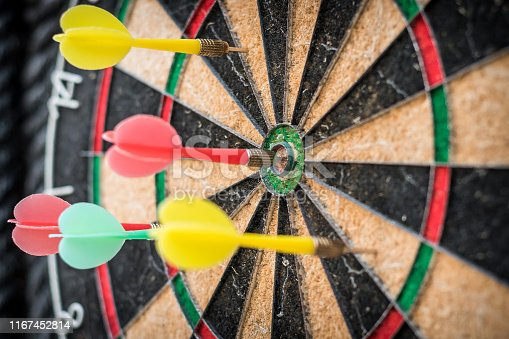 istock Target dart game with one win arrow hit on middle point spot and many missing for competitive business marketing concept 1167452814