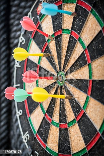 istock Target dart game with one win arrow hit on middle point spot and many missing for competitive business marketing concept 1179678178