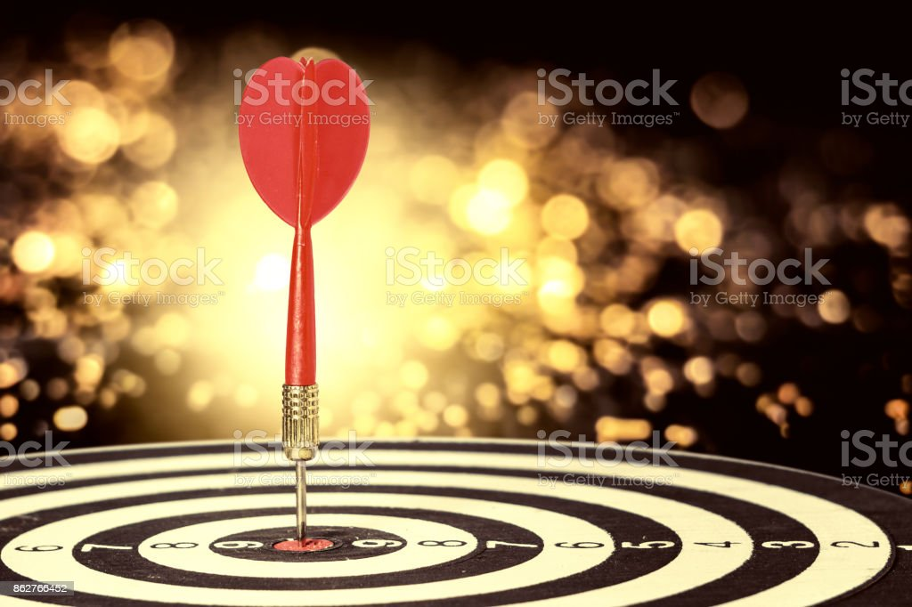 target dart with arrow over blurred bokeh background ,metaphor to target marketing or target arrow concept. stock photo
